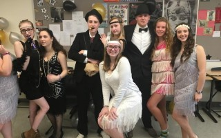 "Mrs. Doyle's Honors American literature class held a Gatsby Party, which is a major project in ""The Great Gatsby"" unit. Students had to research and become a famous icon of the 1920s or a character from the novel. They needed to look like the person, present bio information, perform a representative action, and contribute to the life of the party. Pictured are students dressed as Josephine Baker, Clara Bow, Myrtle Wilson, Bugs Moran, Theda Bara, Jordan Baker, Lucky Luciano, Gilda Gray, and Isadora Duncan.  (photo: )"