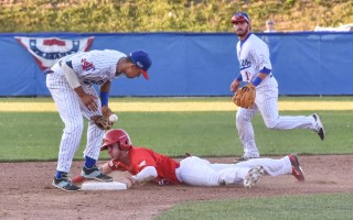 Chatham's Jeremy Pe   ñ   a (14) bobbles the ball as Romy Gonzalez (5) of Orleans slides into second during game play Sunday night at Veterans Field. Kat Szmit Photo  (photo: )