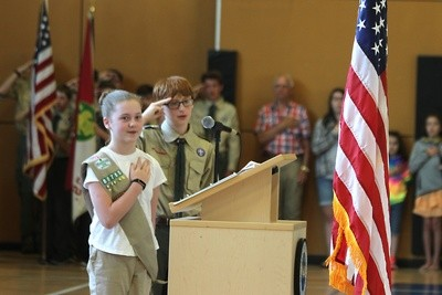 Scouts Ashley Anderson and Lir Wood lead the Pledge of Allegiance.