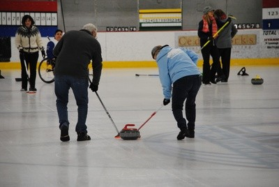 Players sweep down the ice in the heat of the match.