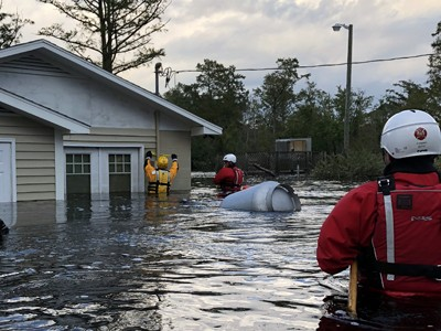 Tech rescue members search a flooded home.  COURTESY PHOTO
