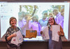 Monomoy Spanish teacher Liz Hoff and student Molly Daley share letters from students of the Kasubi Parents' Secondary School in Kampala, Uganda, seen waving in a video behind them. Kat Szmit Photo  (photo: )