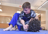 Lance Manning executes a move in the hope of getting Ricky Martinez to submit during a summer jiu jitsu practice at Monomoy High. Kat Szmit Photo  (photo: Kat Szmit)