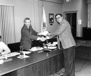 Ronald Lopes turns over the deed for a 1.61 acre parcel adjacent to Flax Pond. 1995. FILE PHOTO  (photo: )