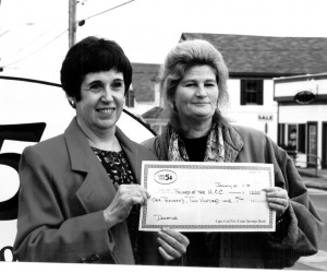 Jane Healy of Friends of the Harwich Community Center receives a donation from Mary Hall of the Harwich Port Cape Cod Five.1999. FILE PHOTO  (photo: )