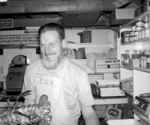 In July 1962, Willard Nickerson hoists a lobster at his popular fish pier market, Nickerson's Fish and Lobster, which he opened in the 1950s. That summer was Chatham's 250th anniversary and Nick, like many other male Chatham residents, sported a full beard to mark the occasion.Chapman Loggia Photo Archive.  (photo: )