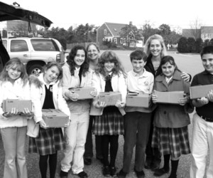 Fifth graders from the Holy Trinity School unload cases of cranberry jelly donated to the Family Pantry by Debbie Greiner and Tina Labossiere of Cape Cod Cranberry Harvest, 2009. FILE PHOTO  (photo: )