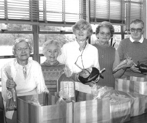 COA distributes holiday packages in 1988. From left are Susan Gately, Alice McCarthy, Frances Kane, Alma Smith and Al Southwick.  FILE PHOTO    (photo: )
