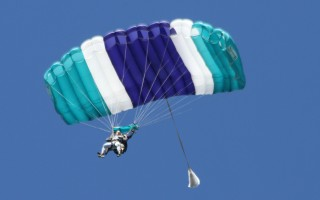 Tandem skydivers descend over Chatham in 2012.  (photo: File/Alan Pollock)