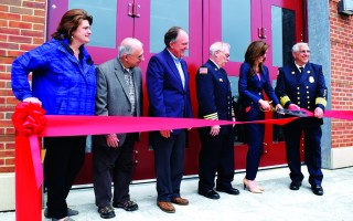 Town Manager Jill Goldsmith cuts the ribbon at the new station Sunday under the watchful eye of Chief Michael Ambriscoe, left. Also attending the ceremony were, from left, Selectmen Amanda Love, Dean Nicastro and Jeffrey Dykens, and Deputy Fire Chief Peter Connick.  (photo: )