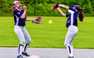 Errors, such as this dropped ball between Carlee Tolley (13) and Eliza Hawthorne (12), proved Monomoy's undoing in MIAA Div. 3 South first round play against Diman on Thursday.  (photo: Kat Szmit)