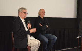"Bob Gale, left, co-creator and producer of ""Back to the Future,"" and actor Christopher Lloyd, who played Emmett ""Doc"" Brown in the classic film series, at a question and answer session following a screening of the original film at the Chatham Orpheum Theater last Wednesday. TIM WOOD PHOTO  (photo: )"