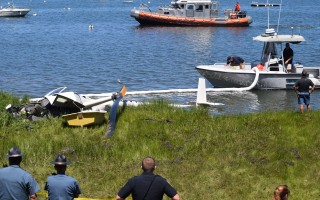 Chatham Harbormaster personnel deploy a boom around the wreckage of a helicopter at the edge of Crow's Pond last Friday to contain any oil or gas leakage. TIM WOOD PHOTO  (photo: Tim Wood)