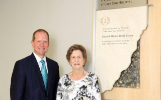 Elizabeth Stevens' sister, Judith Palmer of Harwich Port, is pictured with Cape Cod Healthcare CEO Michael Lauf next to the naming plaque for the intensive care unit at Cape Cod Hospital.  COURTESY PHOTO  (photo: Courtesy Cape Cod Healthcare)