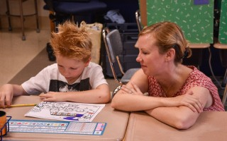 A student at Harwich Elementary School works with a teacher on opening day 2015. School starts for Monomoy, Cape Tech, and the Cape Cod Lighthouse Charter School on Sept. 6. Chronicle File Photo  (photo: Kat Szmit)