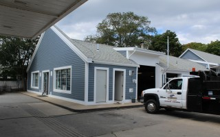 The United Gas station in the center of Harwich Port, owned by Bassil Brothers Trust, adjacent to where the new Cumberland Farms will be built, got a facelift with new siding and trim over the past couple of weeks. WILLIAM F. GALVIN PHOTO  (photo: )