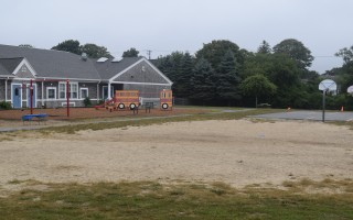 The dusty field at the Chatham Elementary School playground will soon get a makeover, with new irrigation to ensure that grass will grow and survive. TIM WOOD PHOTO  (photo: )