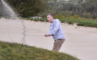 Peter Lucarelli works to get out of a sand trap at Bayberry in Yarmouth. Kat Szmit Photo  (photo: Kat Szmit)