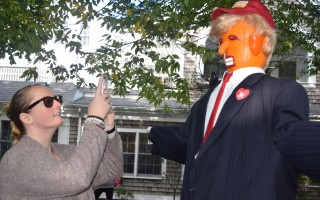 "Michelle Millett, manager of Yankee Ingenuity, takes a photo of the ""Trumpkin"" created by shop owner Jon Vaughan.  (photo: )"