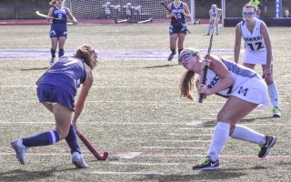 Carlee Tolley (13) knocks the ball away from a Plymouth North opponent. Tolley had a hat trick in Monomoy's 4-0 shutout of the Eagles. Kat Szmit Photo  (photo: Kat Szmit)
