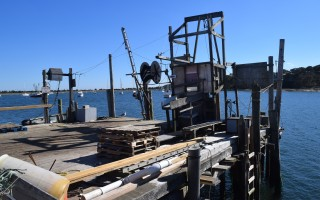 The Eldredge trap dock at Stage Harbor, which was purchased by the town at May's annual town meeting. Waterways Advisory Committee Chairman Peter Taylor last week asked selectmen to accelerate plans to renovate the facility to accommodate the town's commercial fishing fleet, given the poor condition of the inlet into Chatham Harbor. TIM WOOD PHOTO  (photo: )