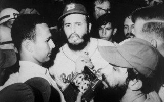 Morton Dean holds a microphone as he interviews Fidel Castro during a baseball game in Havana in 1969. COURTESY PHOTO  (photo: )