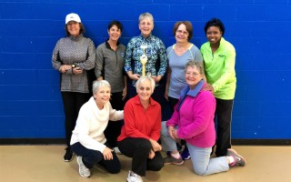 Denise McClung, with trophy, celebrates victory in a recent pickleball tournament with pickleball pals  Chris Walkley, Anne Briggs and Kym Wilkinson, Evelyn Tobey, Carol Coleman, and Sandra Fruean. Contributed Photo  