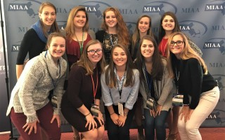 Monomoy softball players Eliza Hawthorne, Karley Marchese, Carlee Tolley, Hannah Potter, Abby Sullivan, Emma Thacher, Sam Barr, and Mollie Charest are all smiles at the presentation of the MIAA Sportsmanship Moment of the Year award at Gillette Stadium in November. Contributed Photo 