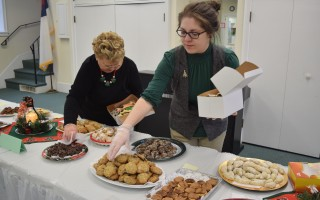 Lily Kaar, right, and Joan Nelson, who created the centerpieces, distribute cookies at Saturday's Cookie Express at the First Congregational Church of Chatham.  (photo: )