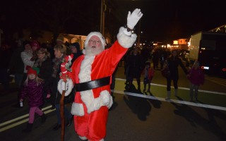 Santa waves to the crowd at last Friday's town tree lighting. TIM WOOD PHOTO  (photo: )