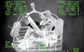 U.S. Coast Guard night vision cameras record the rescue of a boater from North Beach Island Tuesday afternoon.  (photo: )