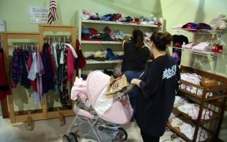 "Family Pantry clients browse the clothing boutique. Some of the used clothing donated to the Family Pantry benefits clients directly, and other items are sold at ""Second Glance,"" the Pantry's upscale thrift shop in West Harwich. FILE PHOTO  (photo: Alan Pollock)"