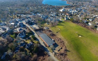 The warehouse on Chatham Bars Inn avenue as seen from above. Owner Chatham Bars Inn is seeking to settle a lawsuit with the town by proposing conditions on continued use of the property as a storage and maintenance facility. CHRISTOPHER SEUFERT PHOTO  (photo: )
