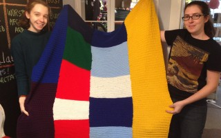 Staff members Antonia DaSilva (left) and Cecilia Bassett unfurl a knitted blanket for the homeless. DEBRA LAWLESS PHOTO   (photo: )