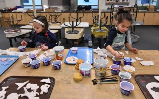 Emily and Myla look like true artists as they complete the glazing of their pottery projects in the final Art 4 Kids class on Feb. 4.  (photo: )