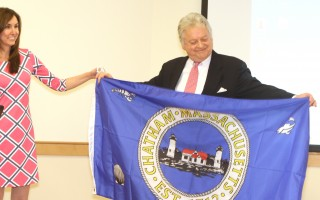 Town Manager Jill Goldsmith presents Tim Roper with a town flag at his last board of selectmen's meeting in 2016. ALAN POLLOCK PHOTO  (photo: )