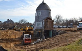 The building around the mill has been cleared away as it awaits being lifted off its foundation and placed on beams for the move. COURTESY PHOTO  (photo: )