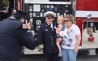 Deputy Fire Chief Peter Connick, shown here with his wife Kathy and granddaughter during last year's dedication of the new fire station, has been named Chatham's new fire chief. FILE PHOTO  (photo: )
