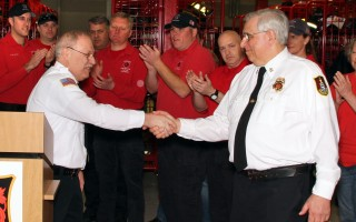 "New Fire Chief Peter Connick and outgoing Chief Michael Ambriscoe share a handshake. ""He has made us what we are,"" Connick said.  ALAN POLLOCK PHOTO  (photo: Alan Pollock)"