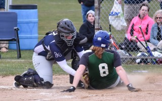 Monomoy catcher Emma Thacher attempts a tag on a D-Y opponent but was just a second too late. Kat Szmit Photo  (photo: )