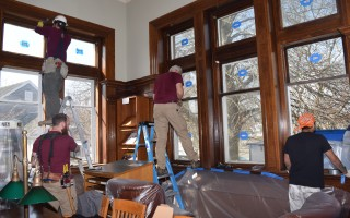 A crew from Essex Restoration prepares to removed historic windows inside the Eldredge Public Library reference room. TIM WOOD PHOTO  (photo: )