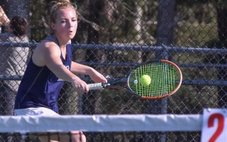 Monomoy's Carly Donovan, who will continue her tennis career at Regis in the fall, returns a shot in match play against Nauset. Kat Szmit Photo 