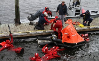 Fishermen practice using survival suits and a life raft in a safety session sponsored by Fishing Partnership Support Services. The organization has conducted safety-at-sea training for 426 fishermen on Cape Cod, 123 of whom were in Chatham. FILE PHOTO  (photo: Alan Pollock)