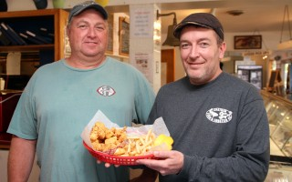 "Chatham fisherman Tim Linnell (left) and Paul Dineen of Chatham Fish and Lobster are among those collaborating in the Pier to Plate program. Dineen has added ""Shark Bites"" to the menu: chunks of flaky dogfish fried in a gluten-free batter and served with fries. ALAN POLLOCK PHOTO  (photo: Alan Pollock)"