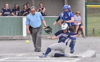 Monomoy's Karley Marchese (11) slides into home beneath an errant ball during game play against St. John Paul II on May 18. Kat Szmit Photo  (photo: )