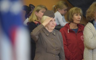 Veteran Jo Ann Sprague salutes during the National Anthem.  TIM WOOD PHOTO  (photo: Tim Wood)
