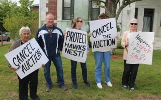 Liz Watkins, Jim Cheverie, Sandy Hall, Debora Miller and Peggy Gabour protested the planned tax lien auction outside town hall in Harwich last week. They got their way when the auction was delayed the next day. WILLIAM F. GALVIN PHOTO  (photo: )