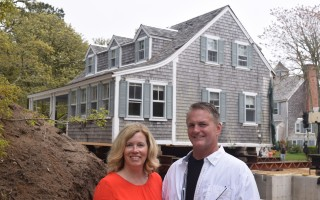 Gwyn and Eric Brittigans in front of the 1762 house they moved from Champlain Road to Sears Road.  (photo: )