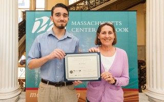 Monomoy Regional High School sophomore Sean Stone and teacher Karen Kelley at the Massachusetts Center for the Book ceremony for winners of the Letters About Literature contest last month. COURTESY PHOTO  (photo: Courtesy photo)