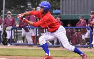 Just before the rains came down in sheets last Friday, Chatham's DJ Artis reached first after a successful bunt. Unfortunately for Artis and his team, the game was called. Kat Szmit Photo  (photo: )